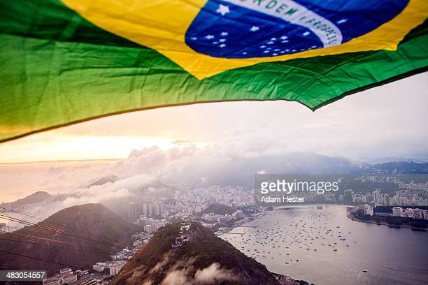 A brazilian flag flying over the top of Rio Brazil