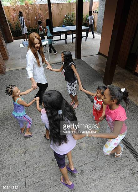 Brazilian Flordelis dos Santos plays with some of her 50 sons four of them her own and another 46 adopted at their home in Niteroi on the other side...