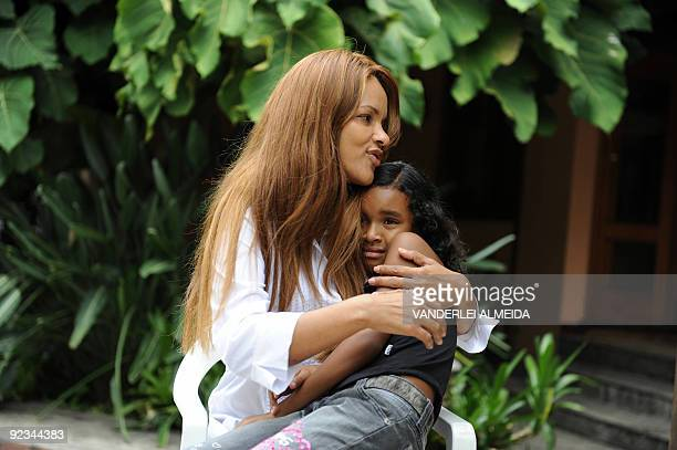 Brazilian Flordelis dos Santos poses with one of her 50 sons four of them her own and another 46 adopted at their home in Niteroi on the other side...