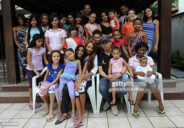 Brazilian Flordelis dos Santos poses with some of her 50 sons four of them her own and another 46 adopted at their home in Niteroi on the other side...