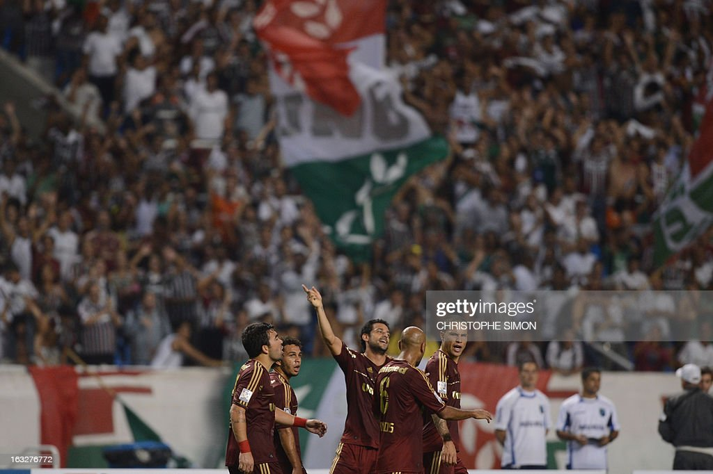 Brazilian Fluminense's Fred (C) jubilates with teammates after scoring a penalty during their Copa Libertadores football match Fluminense vs Huachipato at the Jao Havelange stadium in Rio de Janeiro on March 06,2013.
