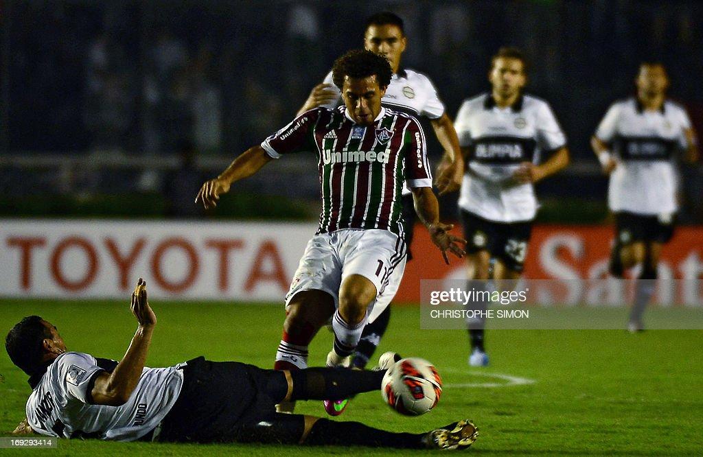 Brazilian Fluminense's Nem Wellington vies for the ball with Paraguayan Olimpia's Julio Cesar Manzur during their Copa Libertadores football match at...