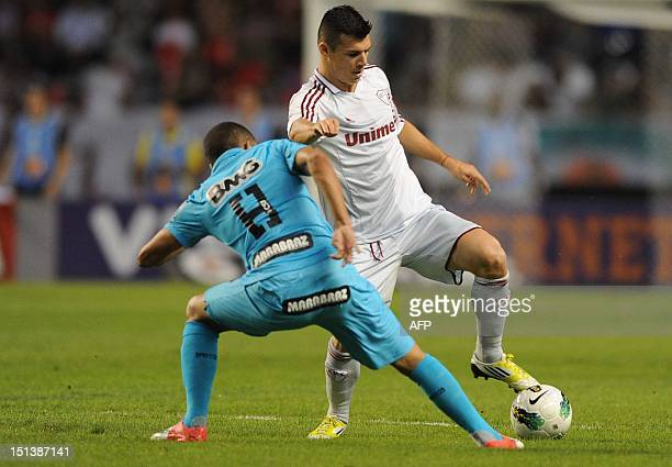 Brazilian Fluminense's Wagner vies for the ball with Santos FC' Gerson during their Brazilian Championship football match at the Joao Havelange...