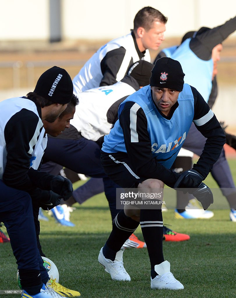 Brazilian football club team Corinthians defender Chicao (R) stretches with his teammates during their training session for the 2012 Club World Cup in Japan tournament at Kariya, Aichi prefecture on December 9, 2012. Corinthians will play in the semi-final match on December 12 at Toyota stadium.