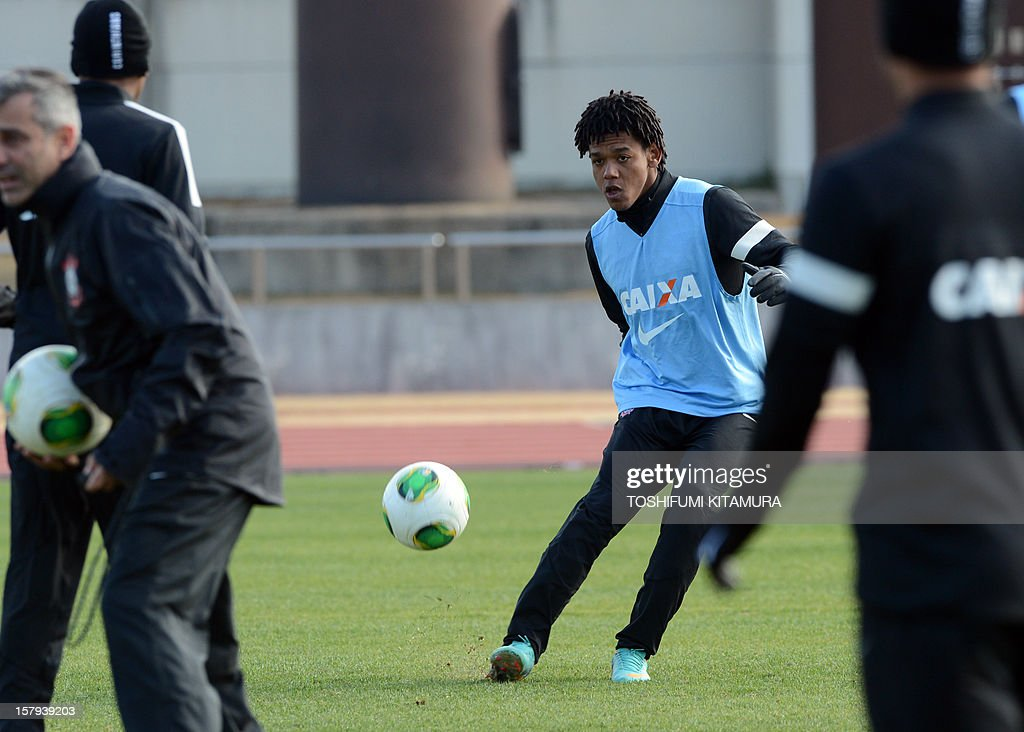 Brazilian football club team Corinthians forward Romarinho (C) kicks the ball during the team's training session in Kariya, Aichi prefecture on December 8, 2012 while participating in the FIFA Club World Cup in Japan 2012. The ninth edition of the FIFA Club World Cup football tournament is taking place from December 6 to 16.
