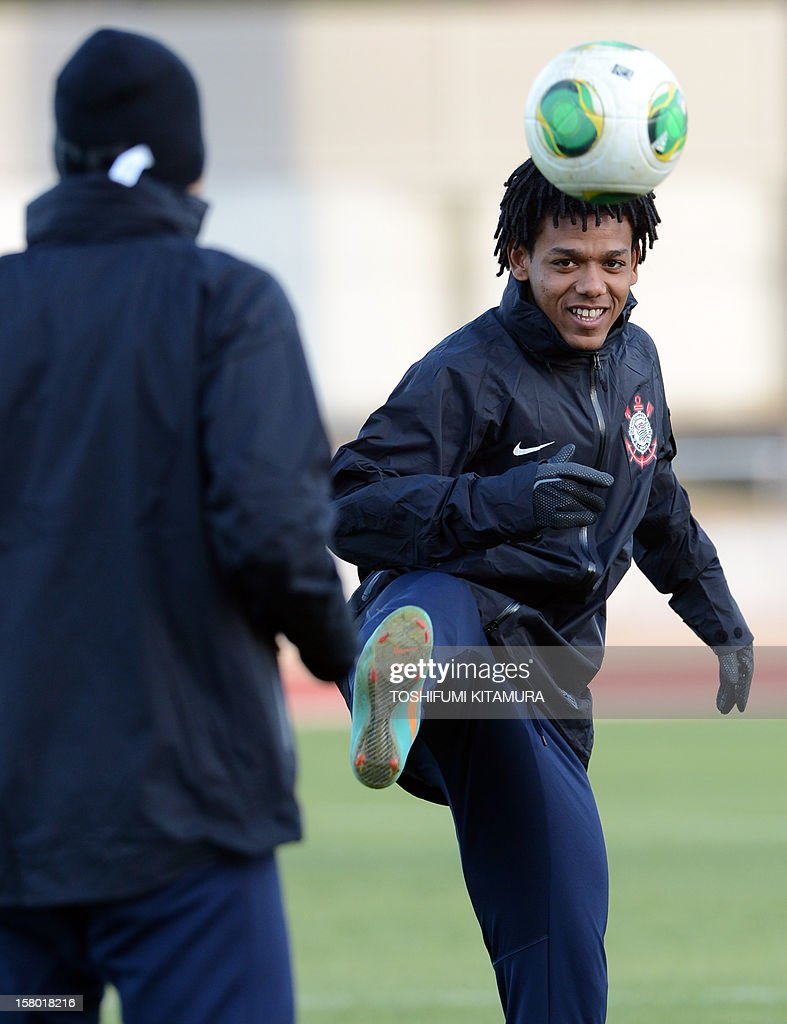 Brazilian football club team Corinthians forward Romarinho (R) kicks the ball during their training session for the 2012 Club World Cup in Japan tournament at Kariya, Aichi prefecture on December 9, 2012. Corinthians will play in the semi-final match on December 12 at Toyota stadium. AFP PHOTO / TOSHIFUMI KITAMURA