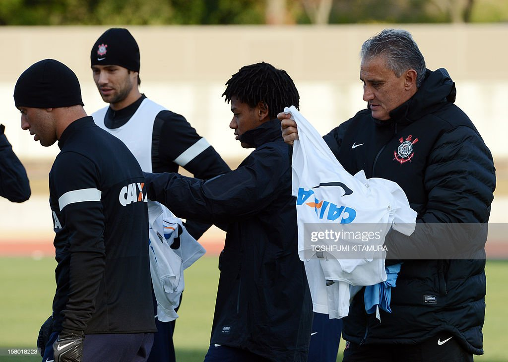 Brazilian football club team Corinthians head coach Tite (R) provides bibs to his players during their training session for the 2012 Club World Cup in Japan tournament at Kariya, Aichi prefecture on December 9, 2012. Corinthians will play in the semi-final match on December 12 at Toyota stadium.