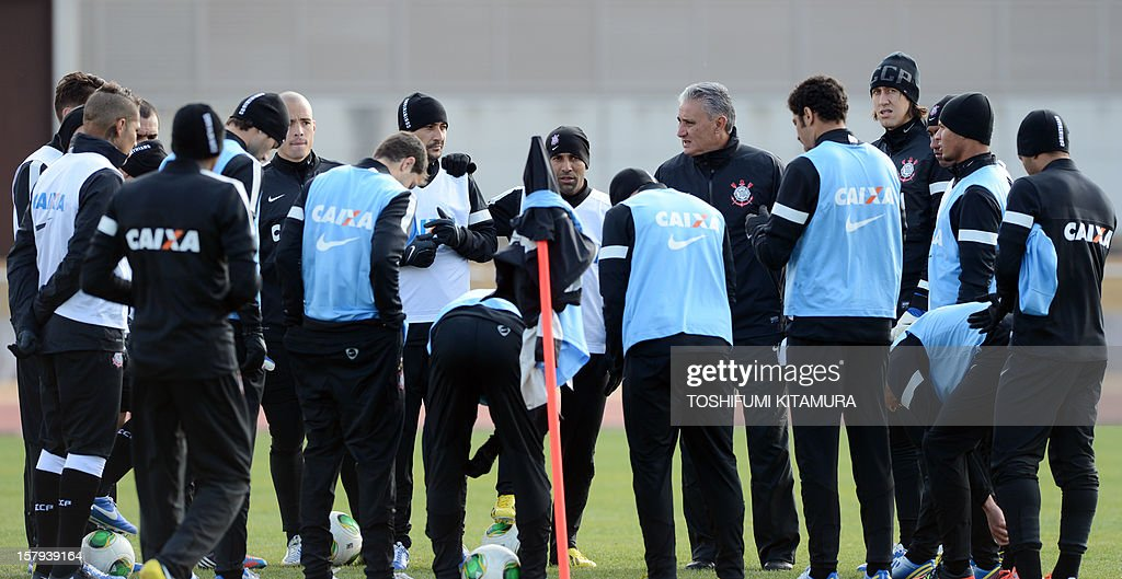 Brazilian football club team Corinthians head coach Tite (5th R) speaks to his players during their training session in Kariya, Aichi prefecture on December 8, 2012 while participating in the FIFA Club World Cup in Japan 2012. The ninth edition of the FIFA Club World Cup football tournament is taking place from December 6 to 16.