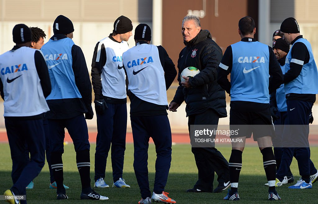 Brazilian football club team Corinthians head coach Tite (5th R) speaks to his players during their training session for the 2012 Club World Cup in Japan tournament at Kariya, Aichi prefecture on December 9, 2012. Corinthians will play in the semi-final match on December 12 at Toyota stadium.