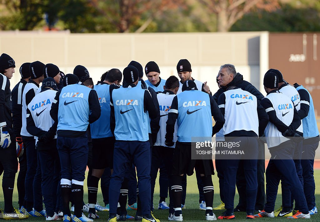 Brazilian football club team Corinthians head coach Tite (4th R) speaks to his players during their training session for the 2012 Club World Cup in Japan tournament at Kariya, Aichi prefecture on December 9, 2012. Corinthians will play in the semi-final match on December 12 at Toyota stadium.