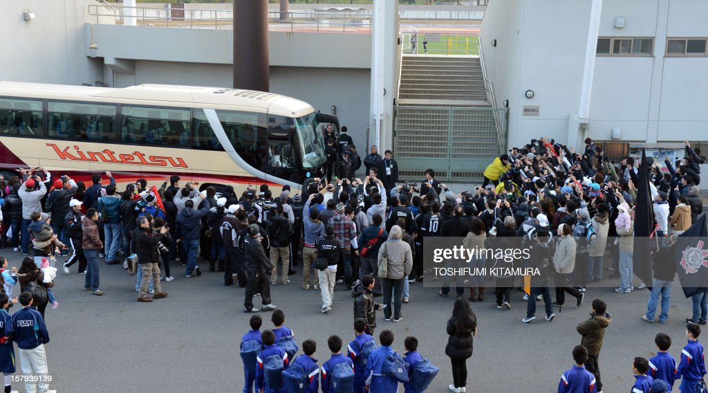 Brazilian football club team Corinthians supporters greet team players upon their arrival prior to the start of their training session in Kariya, Aichi prefecture on December 8, 2012 while participating in the FIFA Club World Cup in Japan 2012. The ninth edition of the FIFA Club World Cup football tournament is taking place from December 6 to 16.