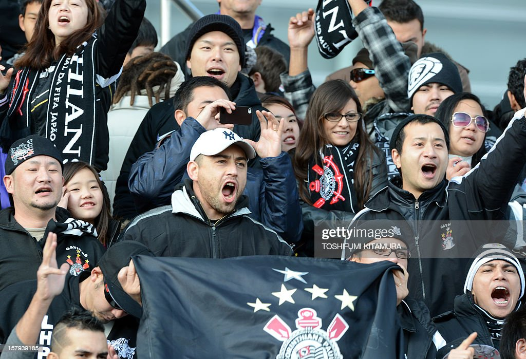 Brazilian football club team Corinthians supporters yell during the team's training session in Kariya, Aichi prefecture on December 8, 2012 while participating in the FIFA Club World Cup in Japan 2012. The ninth edition of the FIFA Club World Cup football tournament is taking place from December 6 to 16.