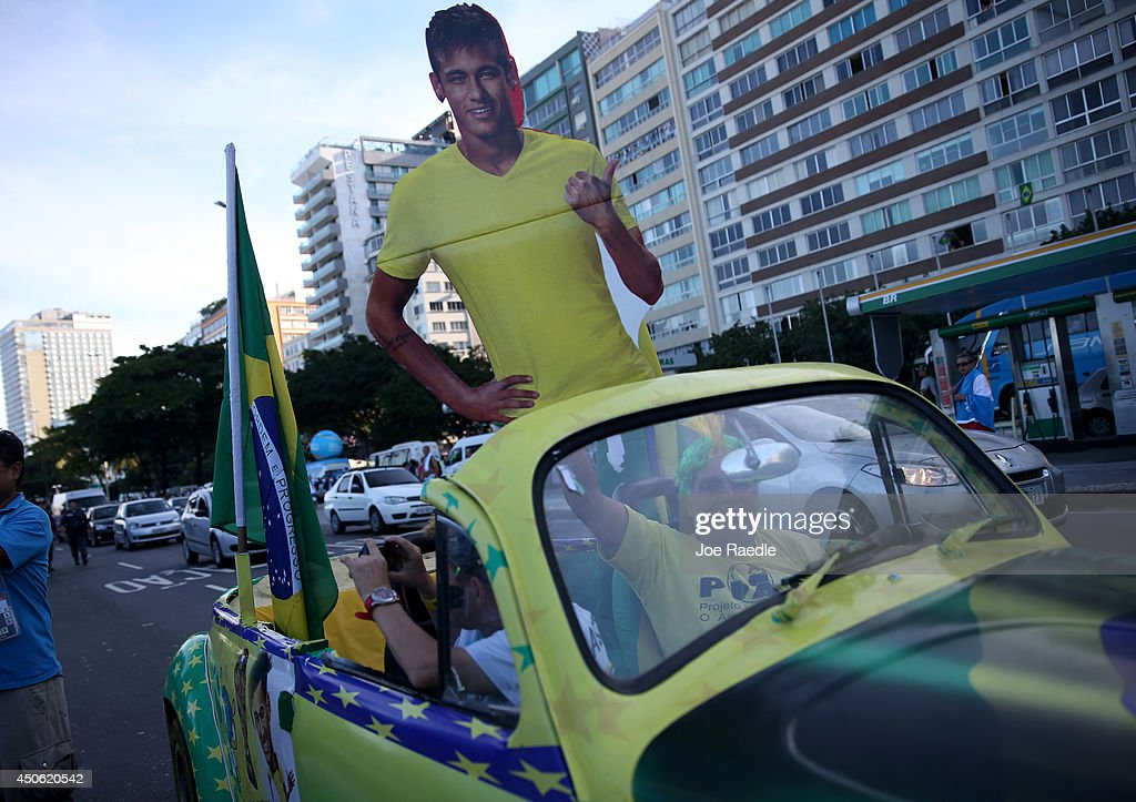 A Brazilian football fan drives through the streets as the FIFA World Cup continues on June 14, 2014 in Rio de Janeiro, Brazil. The games are on their third day of the World Cup tournament.