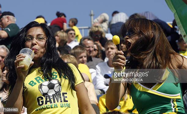 Brazilian football fan enjoys the typical Brazilian drink Caipirinha while singing samba with another fan as the team started his first training...