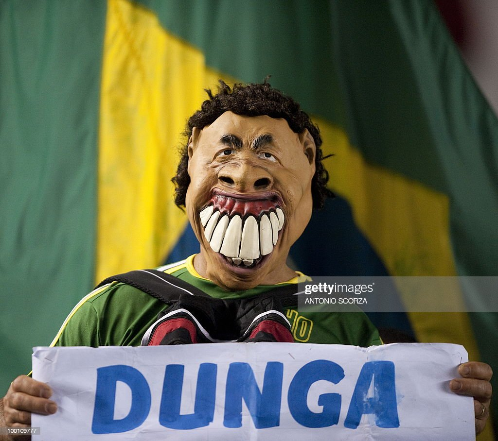 A Brazilian football fan using a mask resembling national head coach Dunga poses for photographers, on May 12, 2010 at the Maracana stadium in Rio de Janeiro before the Flamengo versus Universidad de Chile match for the Libertadores Cup quarterfinals. AFP PHOTO/Antonio SCORZA