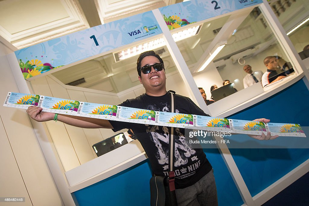 A Brazilian football fan Vanderson Balbino purchases tickets during a FIFA venue ticketing centre opening for the 2014 FIFA World Cup at Casarao General Severiano on April 18, 2014 in Rio de Janeiro, Brazil.