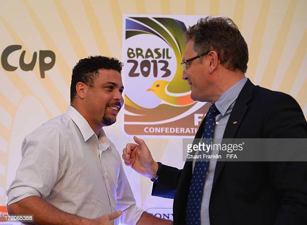 Brazilian football legend Ronaldo greets FIFA General Secretary Jerome Valcke during the wrap up press conference after the FIFA confederation cup...
