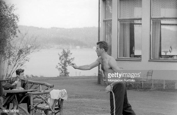 Brazilian football player Hilderaldo Bellini playing darts in the garden at the 1958 FIFA World Cup Stockholm June 1958