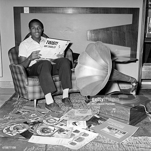 'Brazilian football player Jos Germano de Sales listening the record Do the Twist with Ray Charles on the gramophone Brazilian football player will...