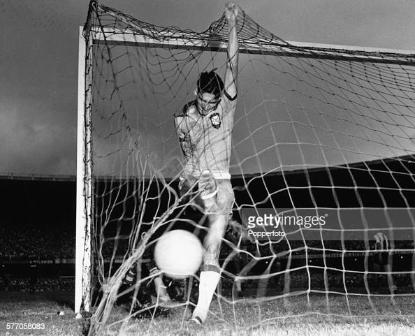 Brazilian football player Julinho follows up his shot to ram the ball in the back of the net in a World Cup qualifying match between Brazil and...