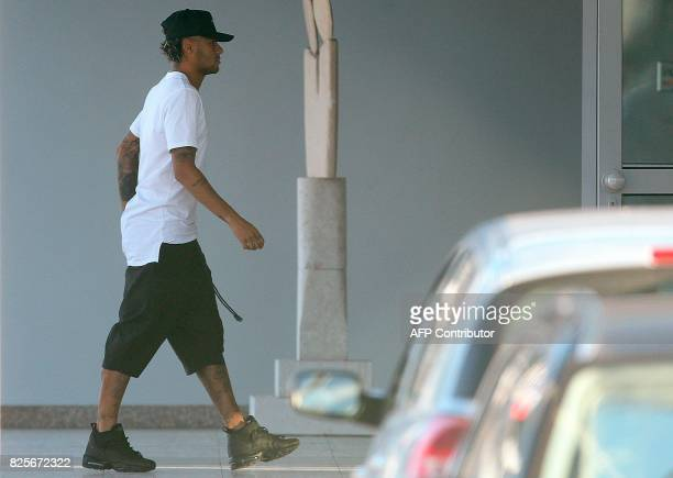 Brazilian football player Neymar is pictured upon his arrival at Francisco Sa Carneiro airport on the outskirts of Porto during a stop over from...
