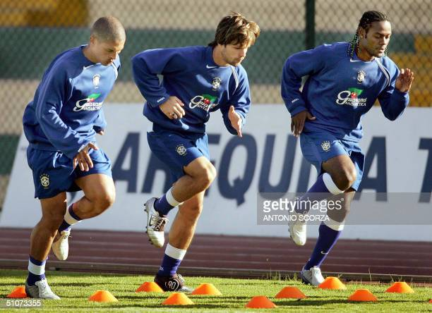 Brazilian football players Alexsandro de Souza Diego da Cunha and Vagner Love train 15 July 2004 the Melgar stadium in Arequipa Peru Brazil will face...