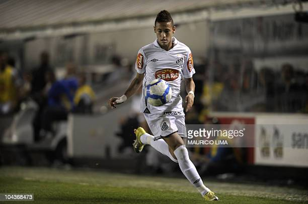 Brazilian football star Neymar of Santos FC controls the ball during their Brazilian Championship football match against Corinthians held at Vila...