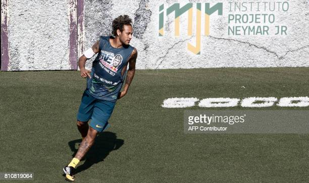 Brazilian football star Neymar plays a match during the finals of a fiveaside global tournament organized by his Neymar Junior Institute project in...