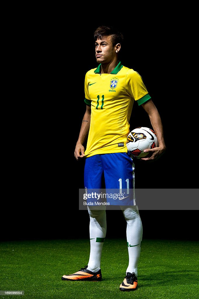 Brazilian football star Neymar presents his new Nike football boots on May 28, 2013 in Rio de Janeiro, Brazil. Neymar signed a five-year contract with Spanish powerhouse FC Barcelona on May 27 and will travel to Spain next week for the official presentation. (Photo by