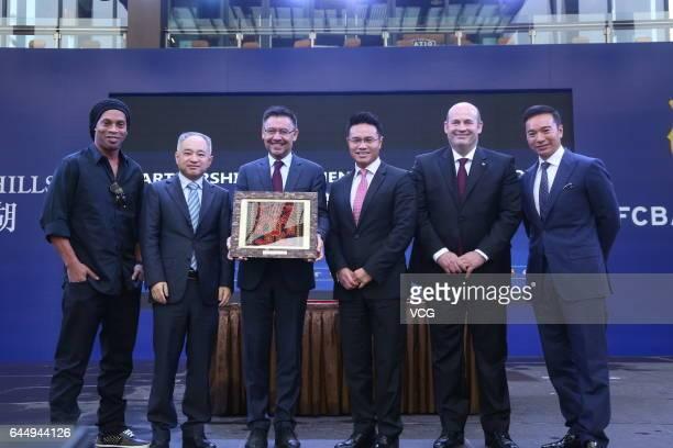 Brazilian football star Ronaldinho Ding Hui the director of Sports in Hainan FC Barcelona's president Josep Maria Bartomeu Ken Chu Chairman of...