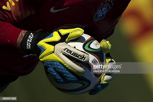 Brazilian football team goalkeeper Julio Cesar takes part in a training session at the squad's Granja Comary training complex in Teresopolis 90 km...