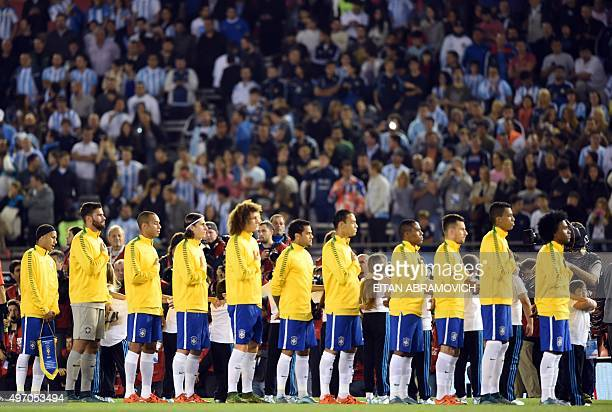 Brazilian football team players attend a minute of silence in honor of victims of attacks that left at least 120 dead in France before their Russia...