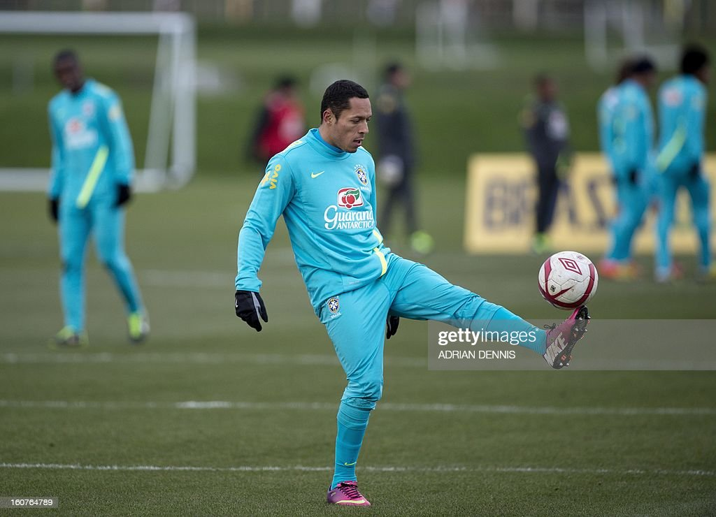 Brazilian footballer Adriano Correia controls a ball during a training session at The Hive, Barnet FC's training ground in Edgware, London on February 5, 2013. Brazil are set to play England in an international friendly at London's Wembley Stadium on February 6, 2013. AFP PHOTO / ADRIAN DENNIS