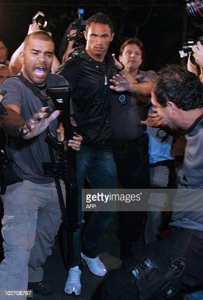 Brazilian footballer Bruno Fernandes de Souza is taken into custody July 7 2010 in Rio de Janeiro Brazil Fernandes de Sousa a star goalkeeper for the...