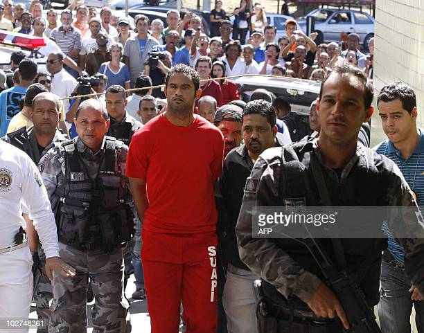Brazilian footballer Bruno Fernandes de Souza is taken under custody to the presidium of Belo Horizonte Brazil on July 9 2010 De Sousa a star...