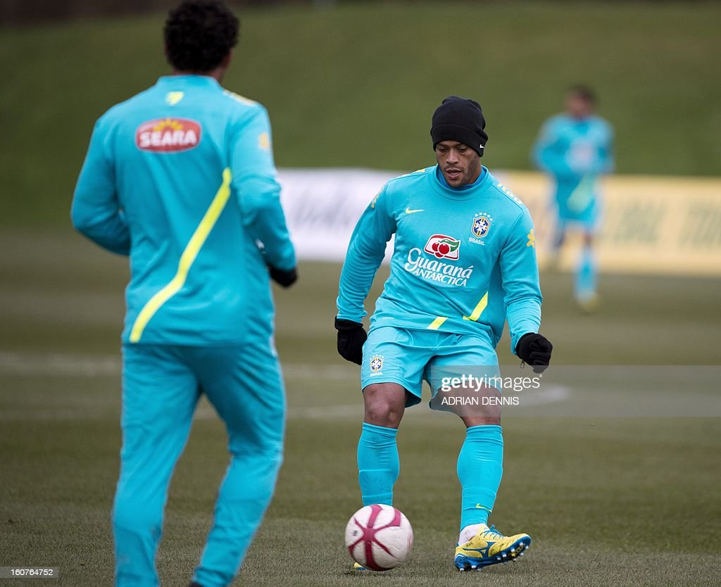 Brazilian footballer Givanildo Vieira de Souza (Foreground-R) (AKA Hulk) controls a ball during a training session at The Hive, Barnet FC's training ground in Edgware, London on February 5, 2013. Brazil are set to play England in an international friendly at London's Wembley Stadium on February 6, 2013.