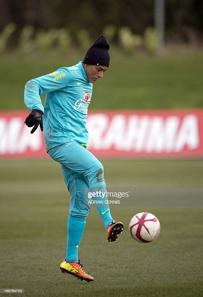Brazilian footballer Neymar controls a ball during a training session at The Hive, Barnet FC's training ground in Edgware, London on February 5, 2013. Brazil are set to play England in an international friendly at London's Wembley Stadium on February 6, 2013.