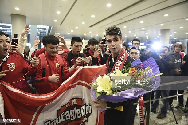 Brazilian footballer Oscar arrives at the airport on January 2 2017 in Shanghai China Oscar and Odil Ahmedov join China super league football club...