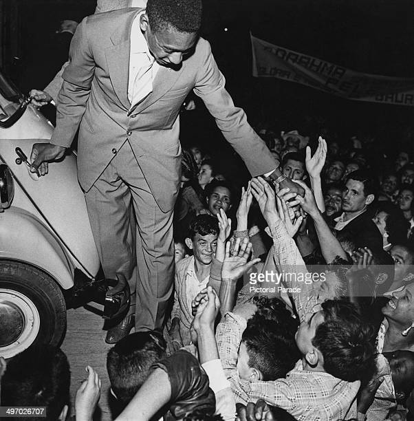 Brazilian footballer Pele and adoring fans with a RomiIsetta presented by the mayor of Bauru to mark his 1958 World Cup victory 1958
