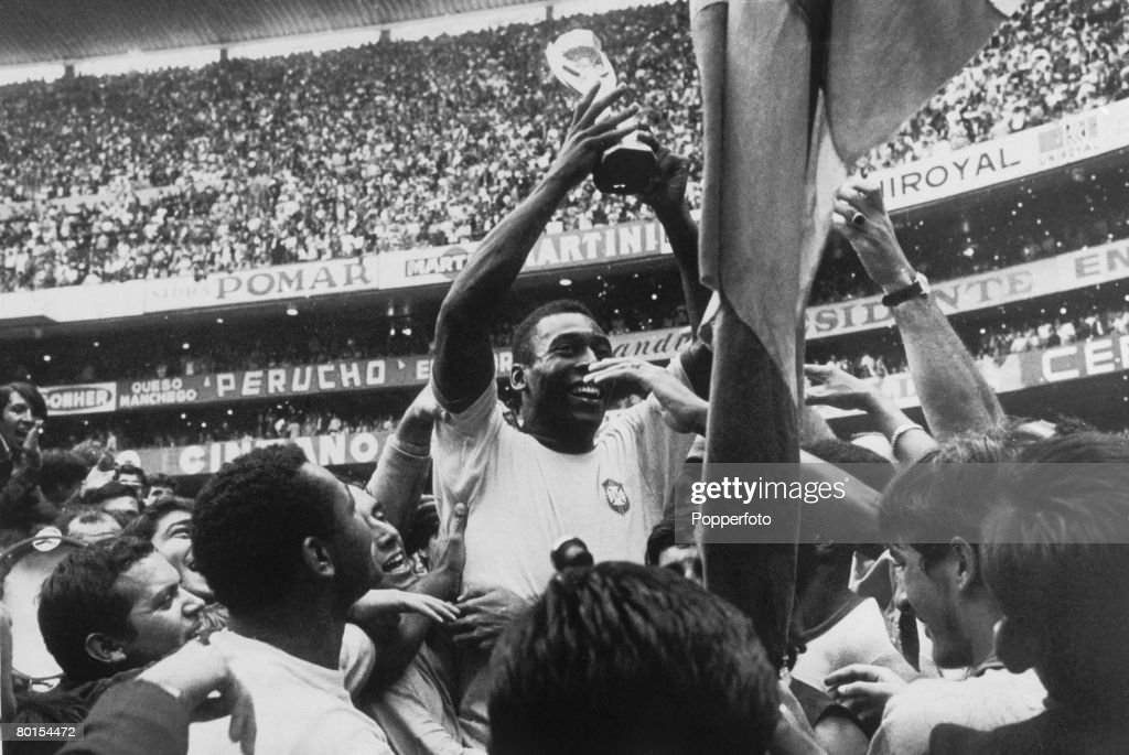 Brazilian footballer Pele holds up the Jules Rimet Trophy after Brazil's 4-1 World Cup Final victory over Italy at the Estadio Azteca, Mexico City, 21st June 1970. Pele scored the first of his team's goals in the match.