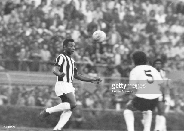 Brazilian footballer Pele in action