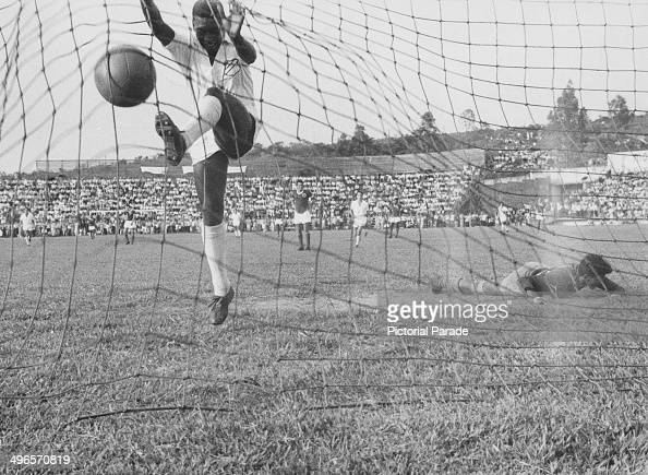 Brazilian footballer Pele in the net after scoring for Santos against Guarani of Paraguay 1958