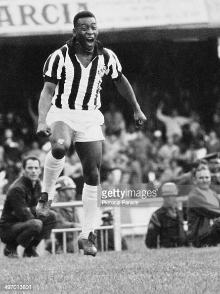 Brazilian footballer Pele jumping in celebration while playing for Santos circa 1968