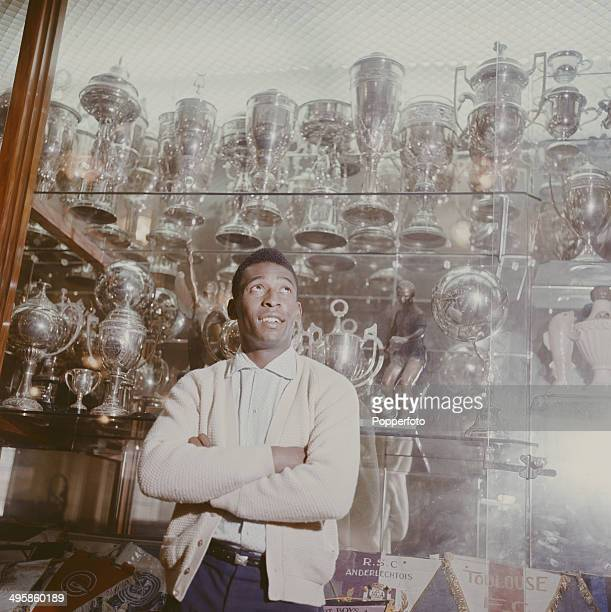 Brazilian footballer Pele pictured standing in front of the trophy cabinet at Santos FC in Santos Brazil circa 1965