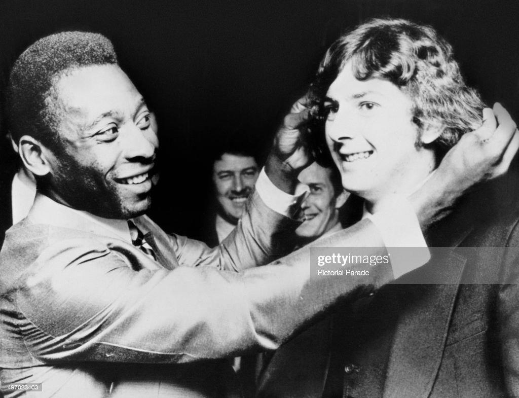 Brazilian footballer Pele teasing Trevor Francis star of Birmingham City FC about his hair 21st February 1972