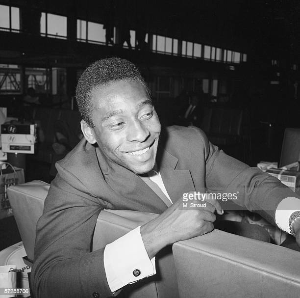 Brazilian footballer Pele waiting at London Airport for his team's plane home after the 1966 World Cup in England 25th July 1966
