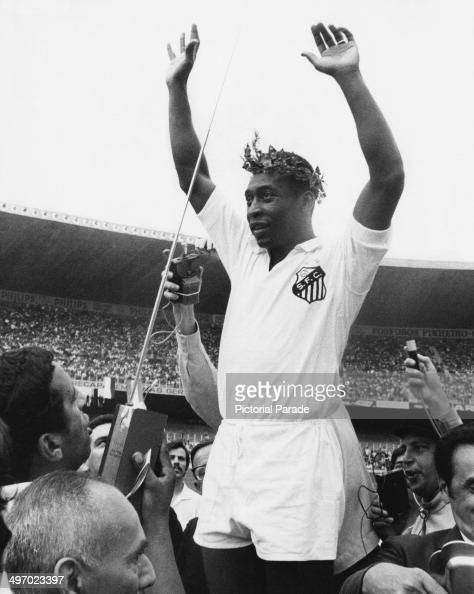 Brazilian footballer Pele wearing a wreath while celebrating with his team Santos FC 24th November 1969