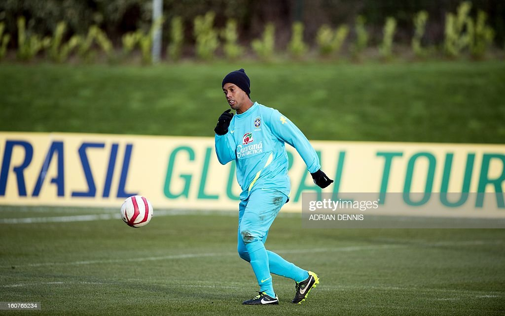 Brazilian footballer Ronaldinho controls a ball during a training session at The Hive, Barnet FC's training ground in Edgware, London on February 5, 2013. Ronaldinho admits he did not expect to be recalled by Brazil, but says he believes the squad he has returned to possesses sufficient quality to win the 2014 World Cup on home soil. After a year in the international wilderness, the 32-year-old forward is expected to feature in Brazil's friendly game against England at Wembley on February 6, 2013.