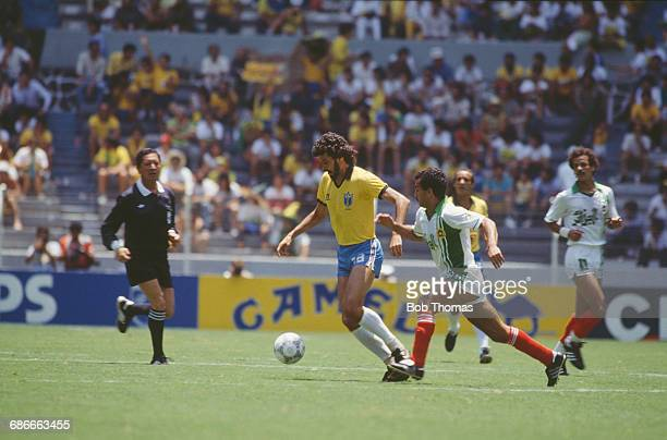 Brazilian footballer Sócrates during a FIFA World Cup Final match against Algeria at the Estadio Jalisco in Guadalajara Mexico 6th June 1986...
