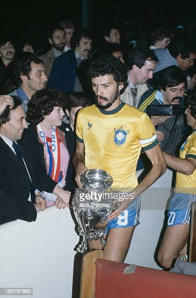 Brazilian footballer Socrates holds the trophy after Brazil beat England 10 in a friendly international at Wembley Stadium London 12th May 1981